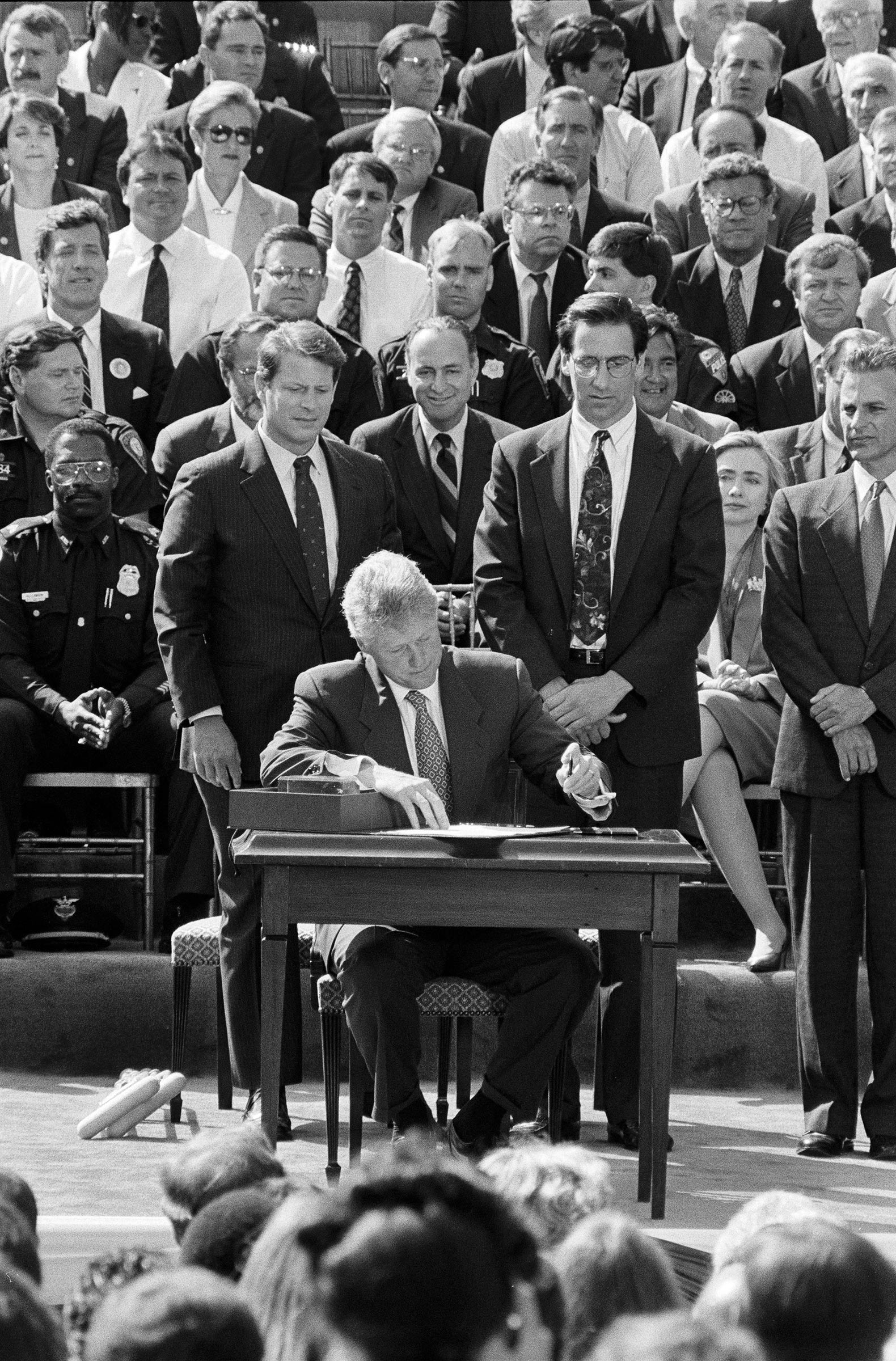 President Clinton signs the Violent Crime Control and Law Enforcement Act at the White House on Sept. 13, 1994.