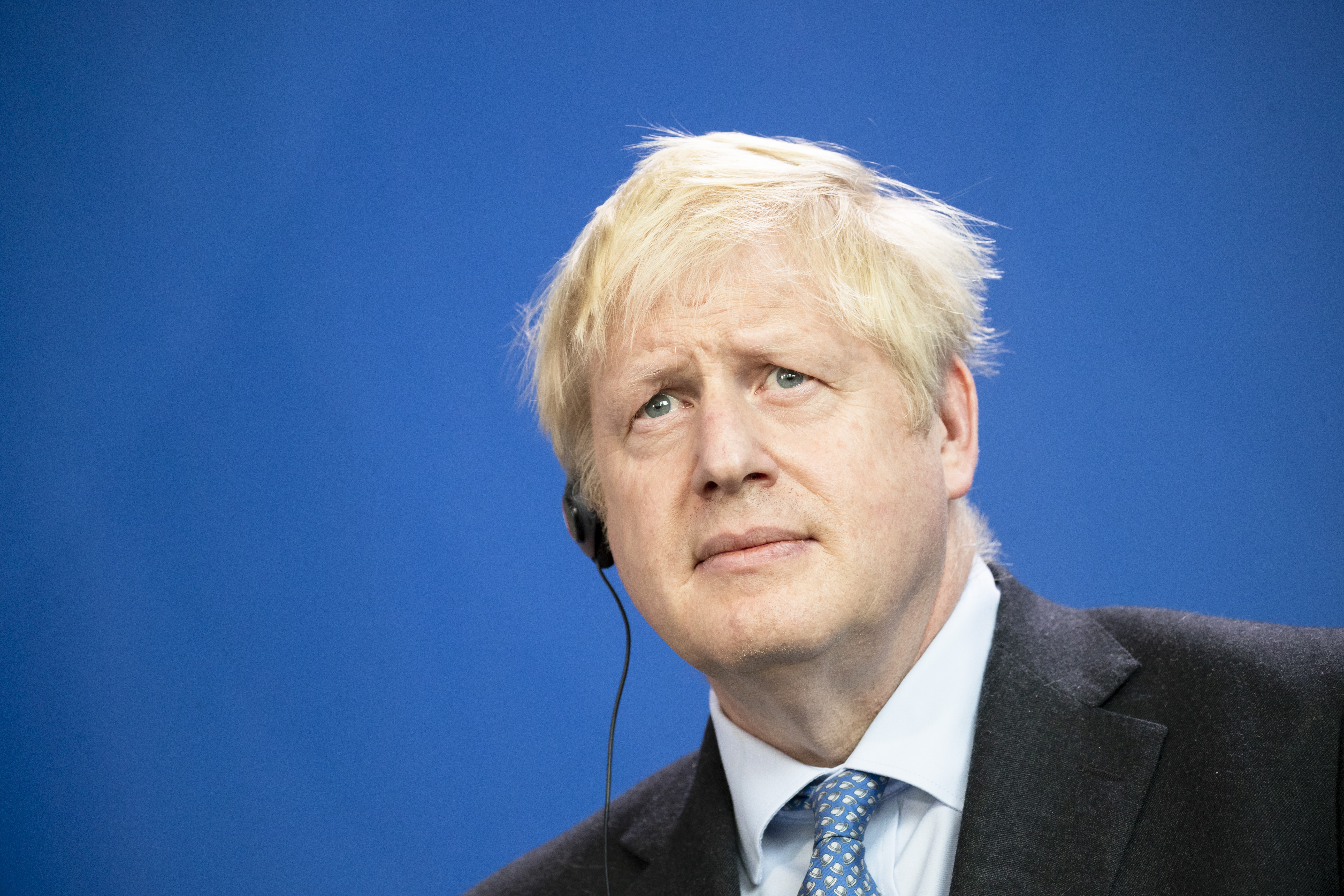 British Prime Minister Boris Johnson is pictured during a press conference at the Chancellery in Berlin on August 21, 2019.