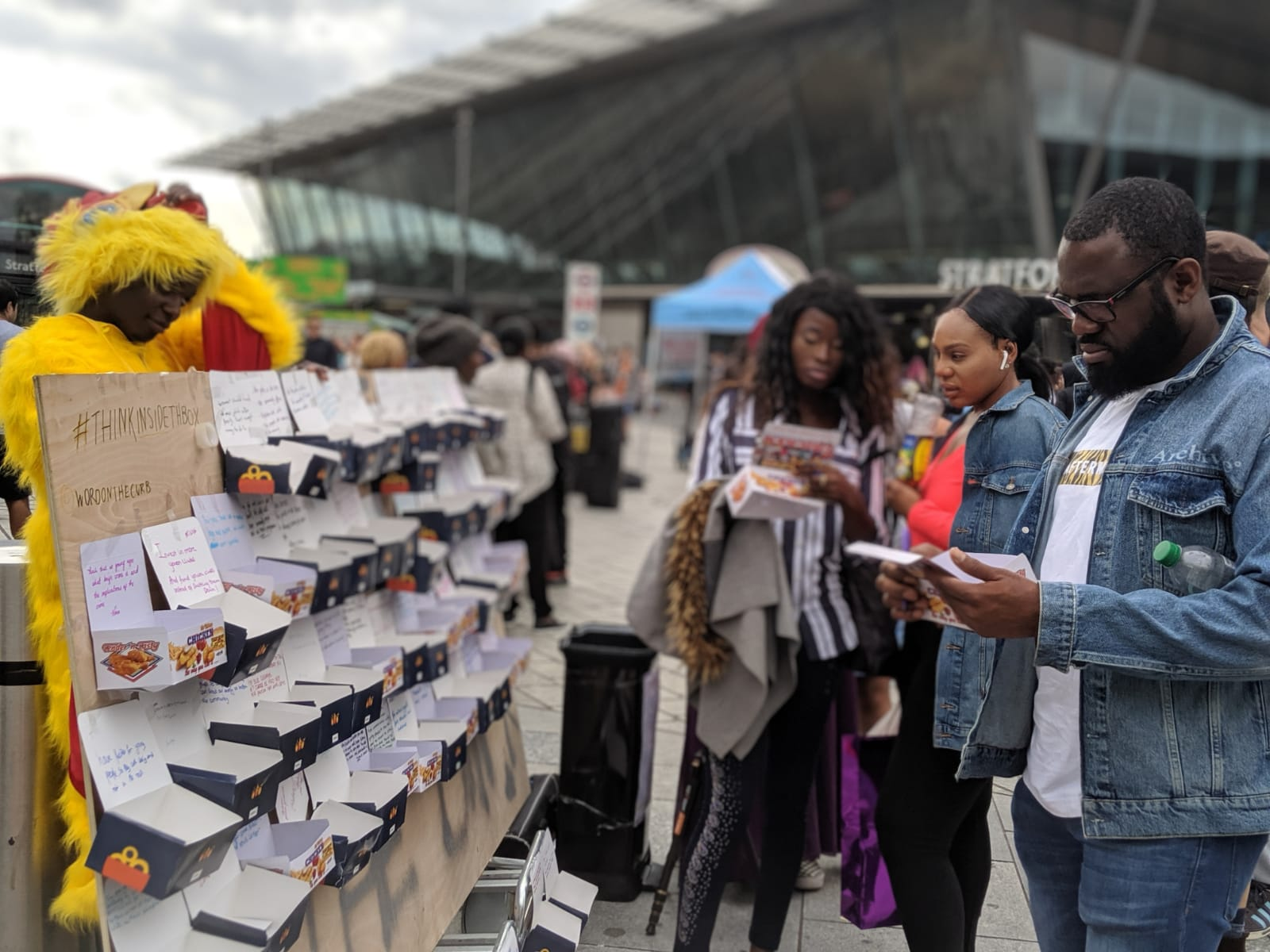 Londoners write messages for chicken boxes as part of Wartemberg and Uchea's #ThinkInsideTheBox campaign