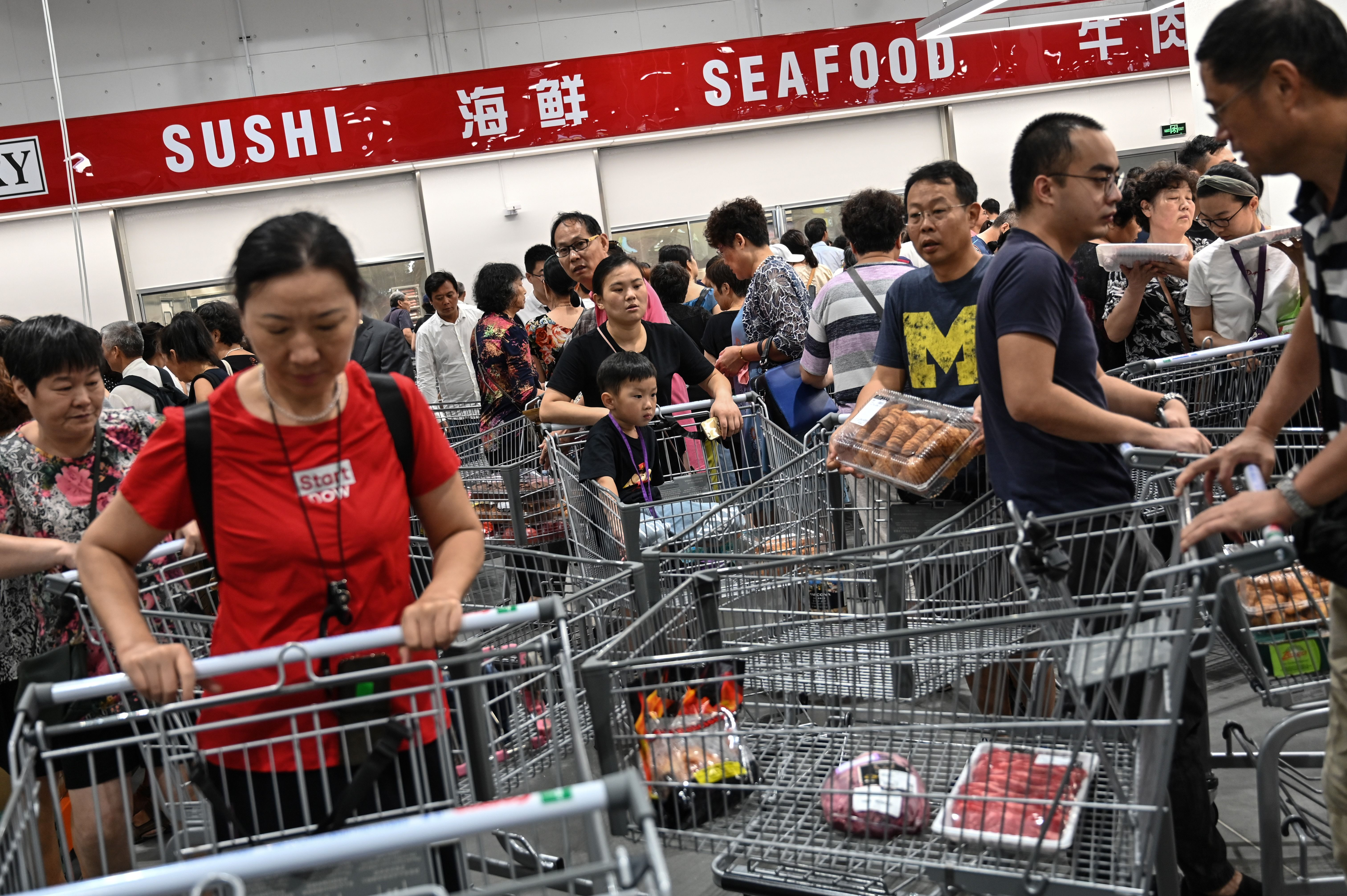 People visit the first Costco outlet in China, on the stores opening day in Shanghai on August 27, 2019. -