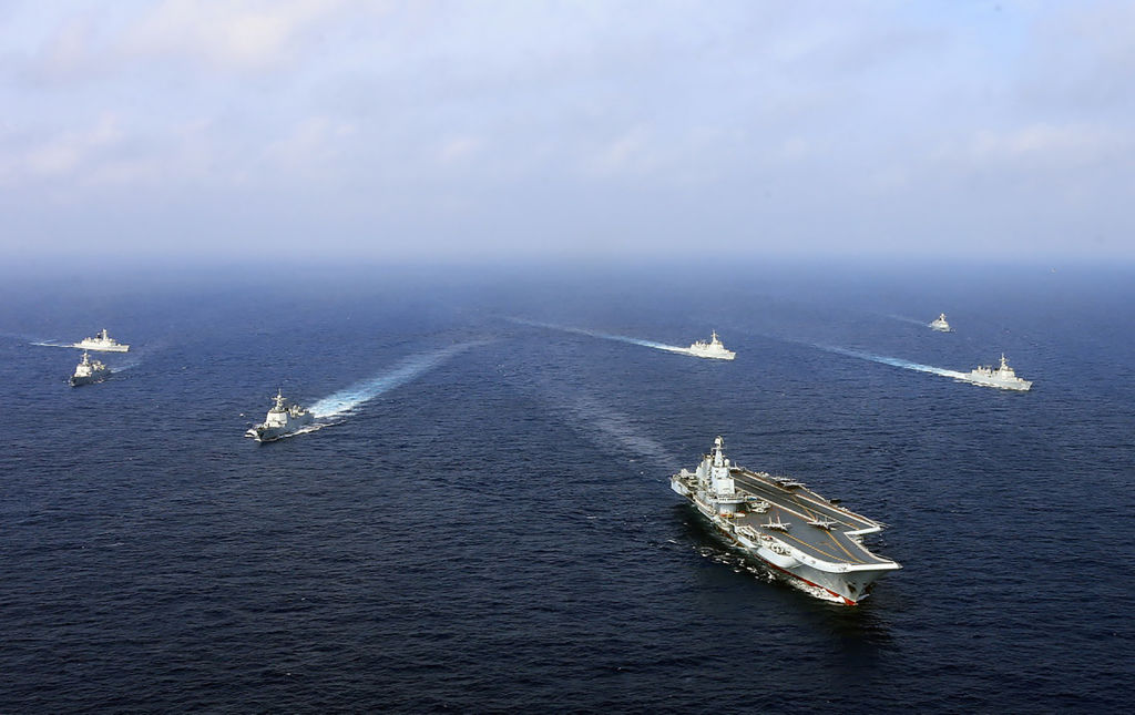 China's aircraft carrier the Liaoning (front), sails with other ships during a drill in April 2018.