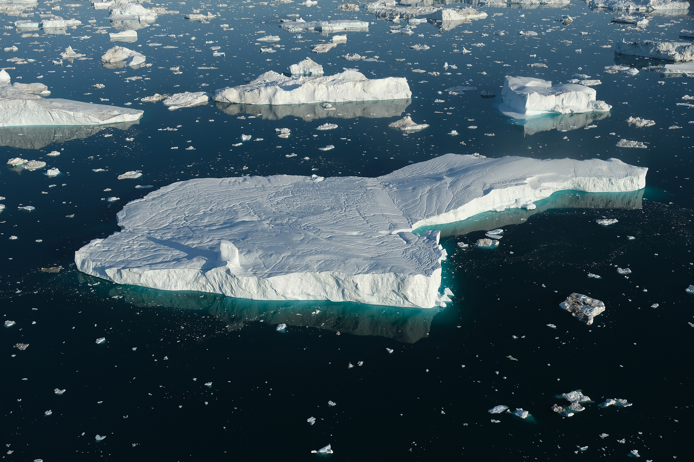 In this view from an airplane icebergs float in Disko Bay on August 4, 2019 near Ilulissat, Greenland.