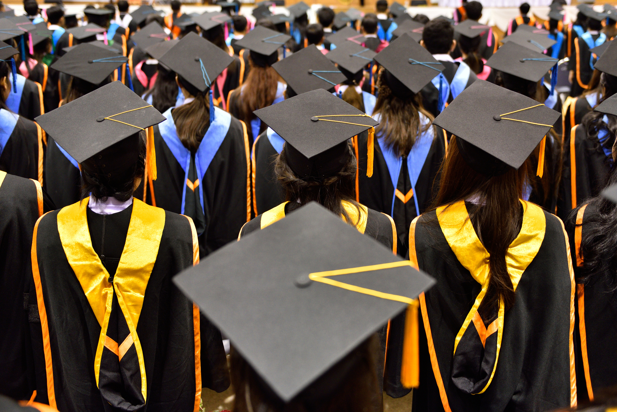 College students graduate in a commencement ceremony.