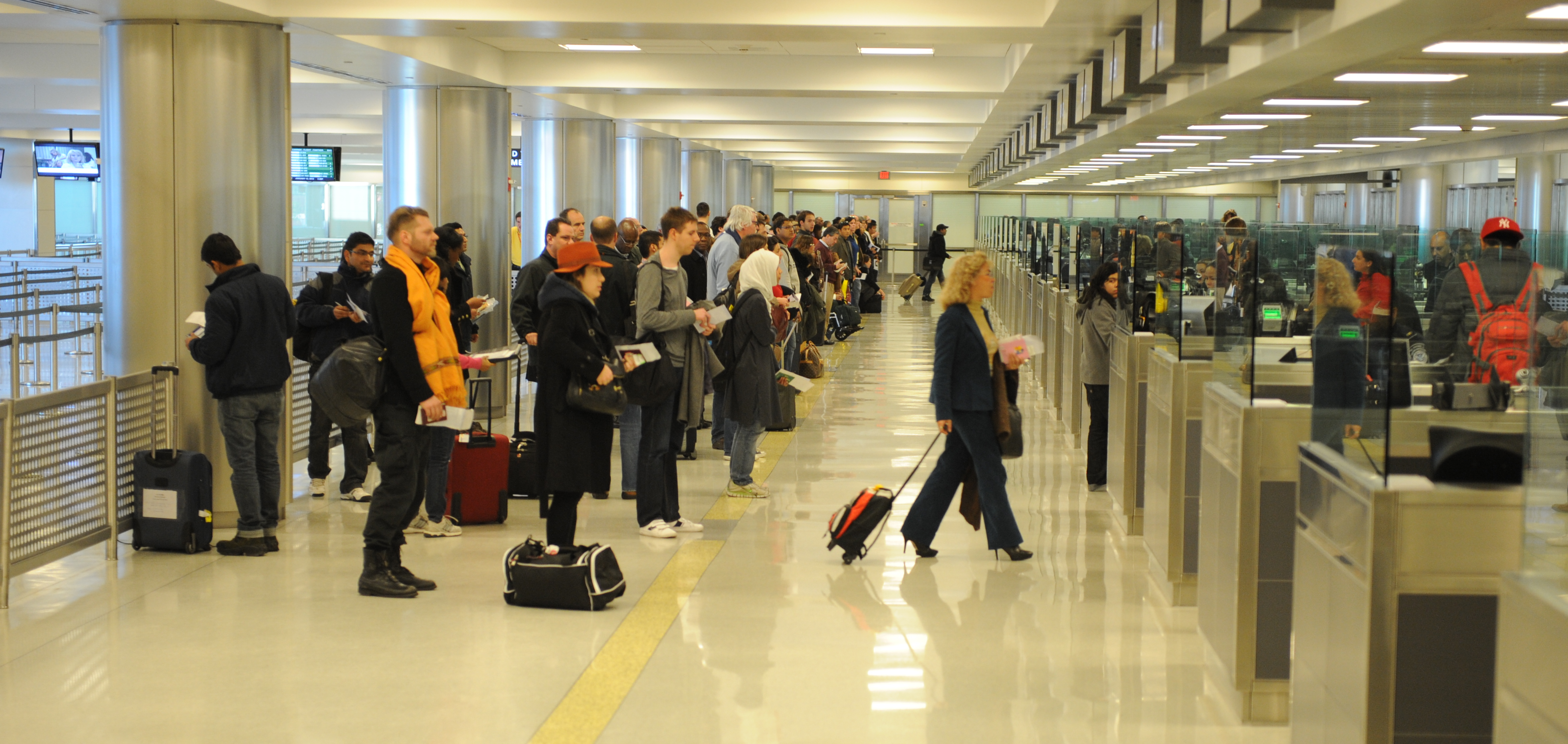 Passengers prepare to pass through international customs at Dulles International Airport on January 13, 2012, in Dulles, VA.