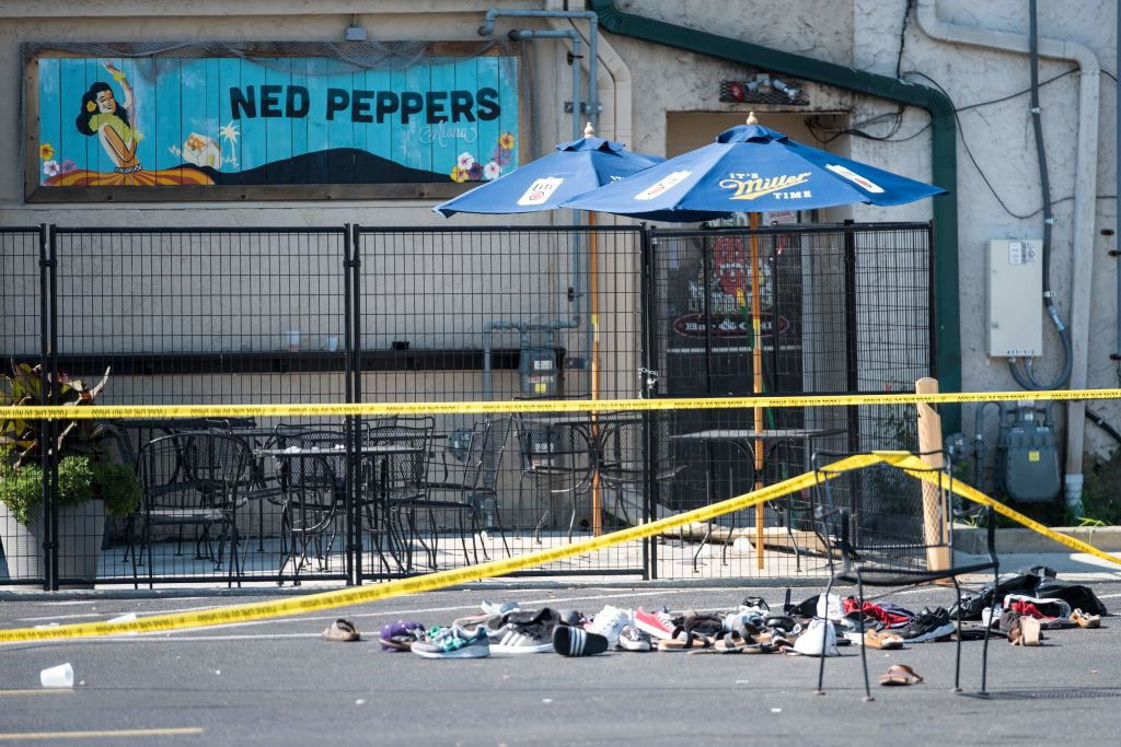 Pairs of shoes are piled behind the Ned Peppers bar belonging to victims of an active shooting that took place in Dayton, Ohio on August 04, 2019.