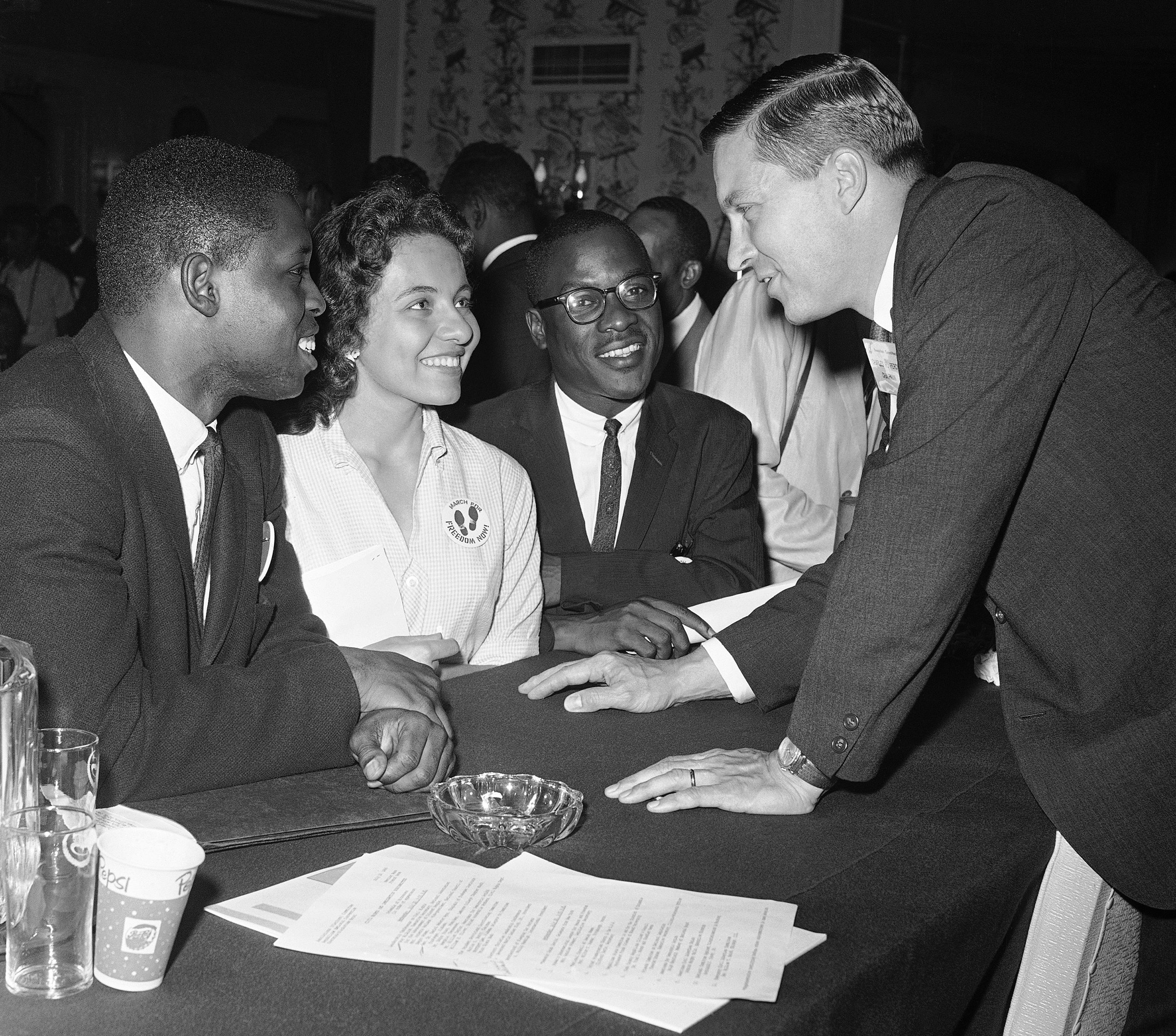 Charles H. Percy (R), chairman of the platform committee of the Republican Party, discusses civil rights with (L-R), Walter Bradford, Diane Nash, and Bernard Lee in Chicago on July 20, 1960.
