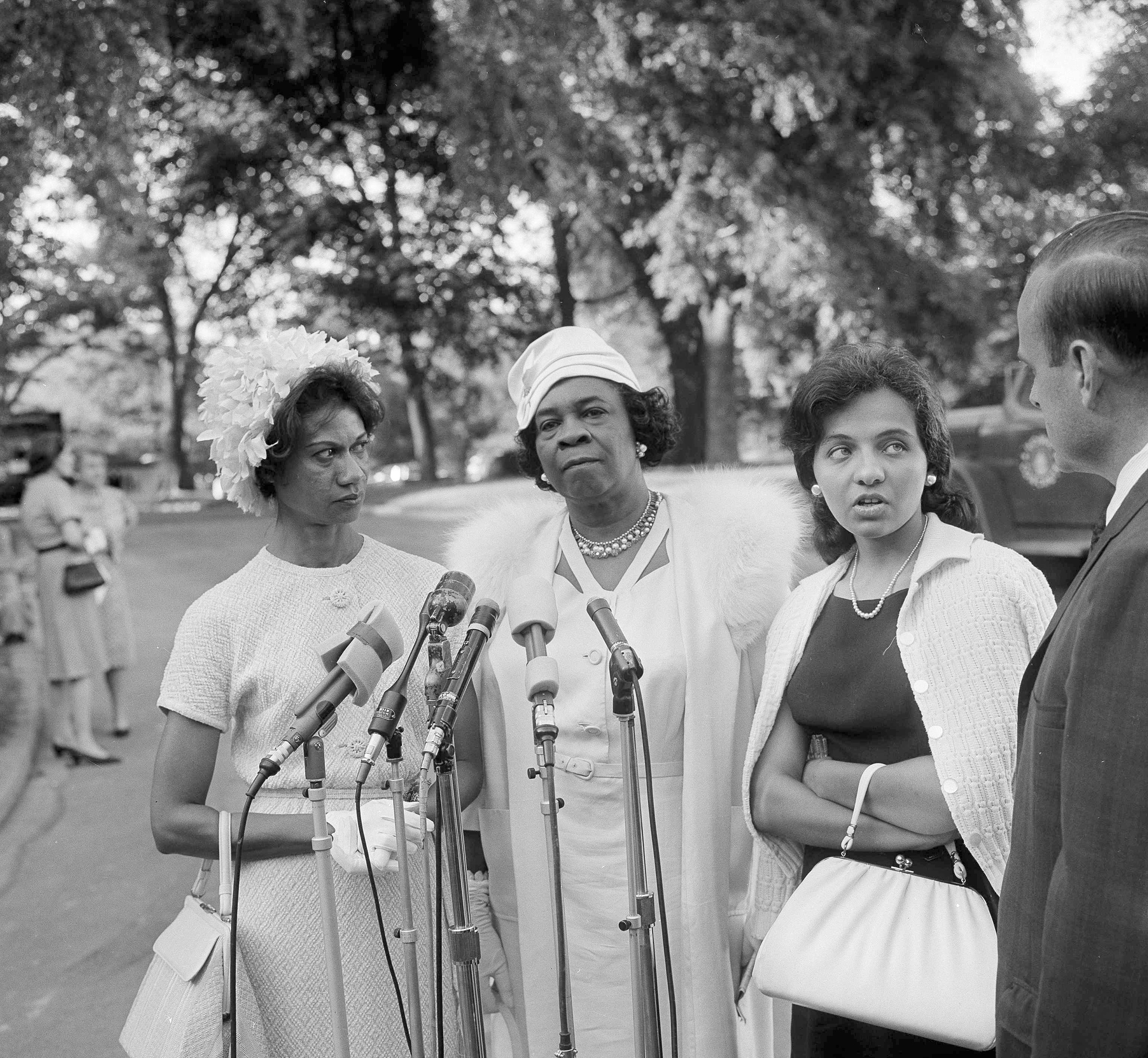 Gloria Richardson, left, a leader in the Cambridge, Md., integrationist's movement, Dr. Rosa L. Gragg of the National Association of Colored Woman's Clubs and Mrs. Diane Nash Bevel, right, representing the Southern Christian Leadership Committee, are interviewed as they leave the White House in Washington, D.C., July 9, 1963.