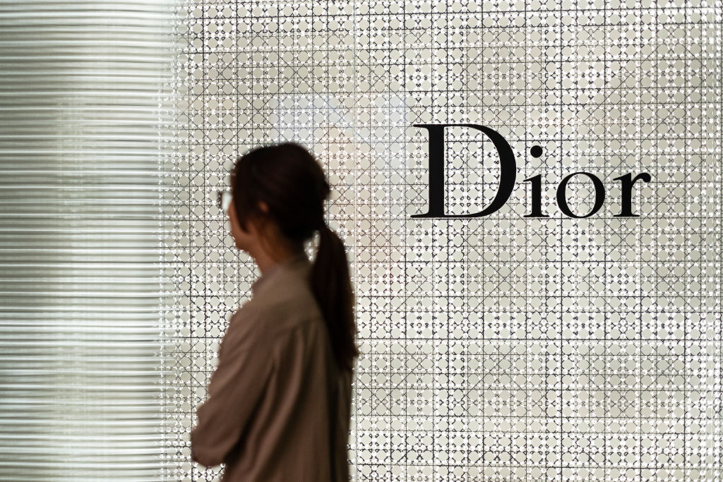 French luxury fashion company Dior's logo seen outside the retail store in Causeway Bay.