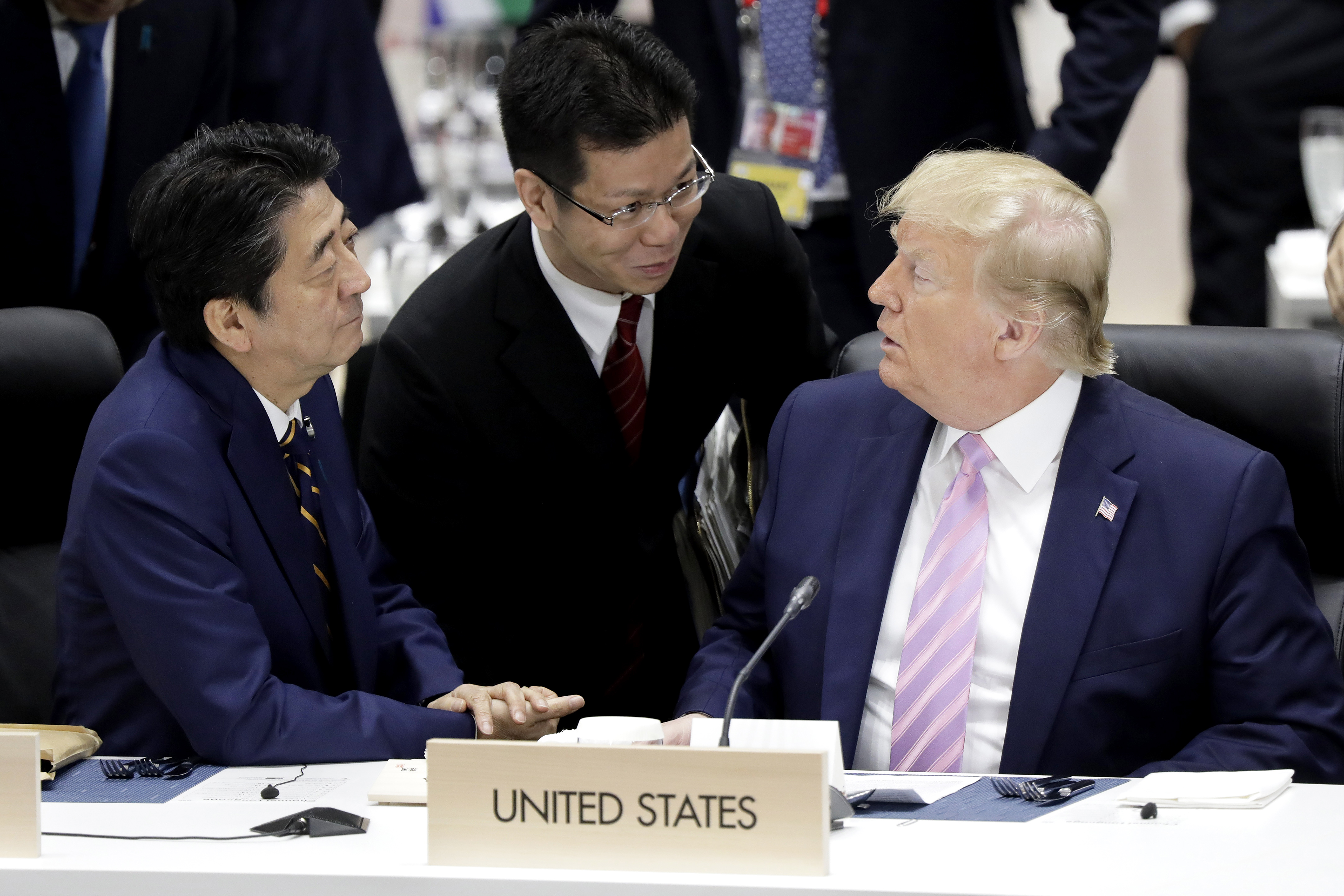 President Donald Trump is waging both a trade war and an emergency currency war. It will be hard for him to win both. He has complained that the value of the Euro and the Yen are too high compared to the dollar. He is seen at the G20 Summit in June 2019 with Japanese Prime Minister Shinzo Abe (left).