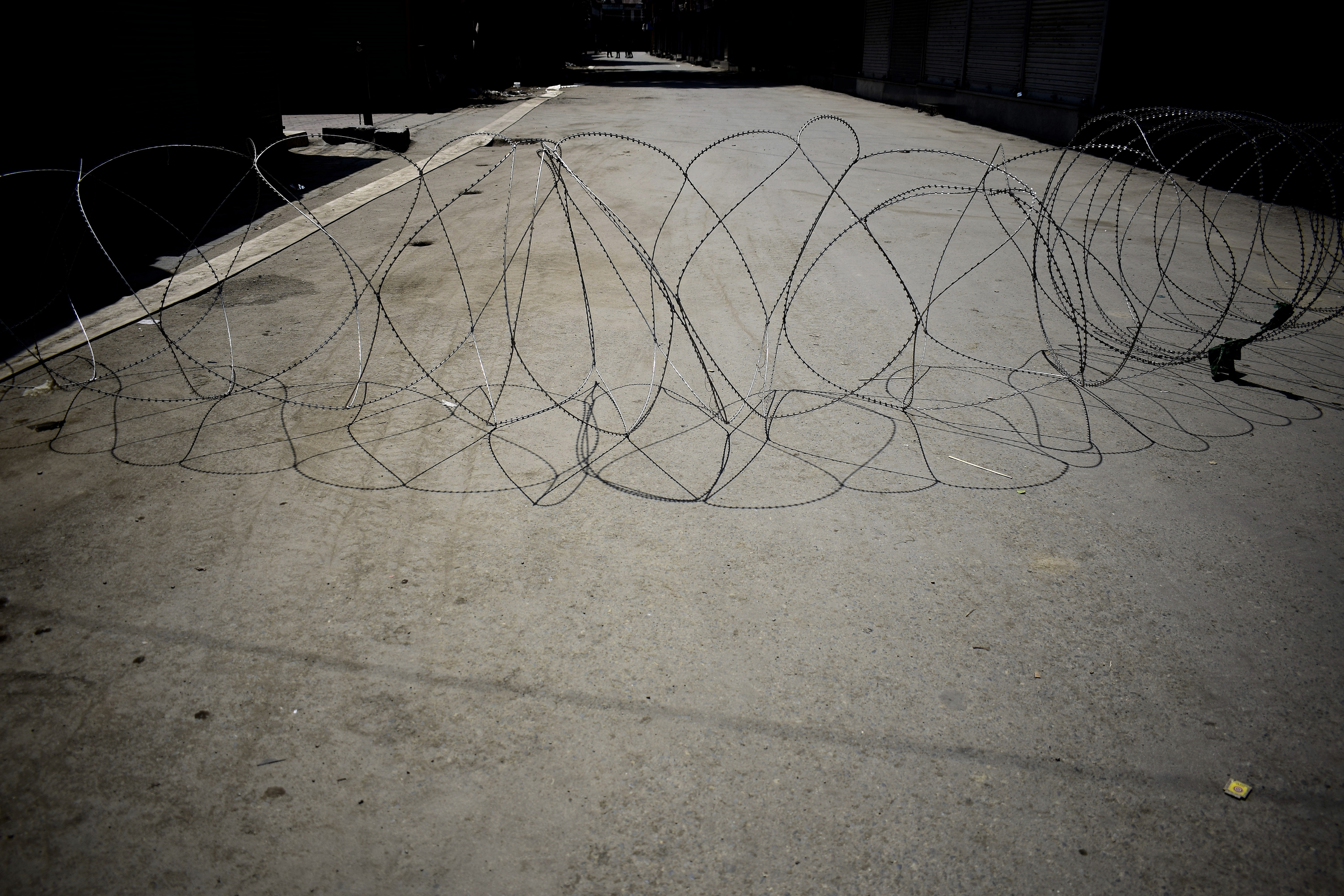 Barbed wire installed to seal roads, imposing curfew, in Srinagar, Kashmir on Aug. 6.