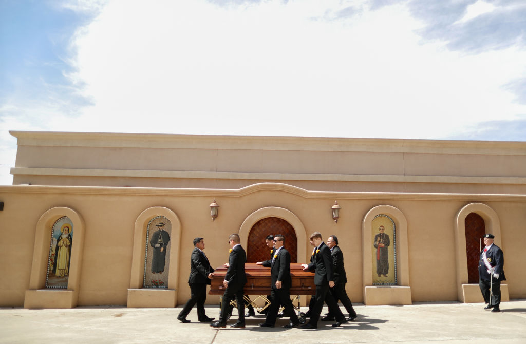 Pallbearers wheel the casket of Angelina Englisbee, 86, who lost her life in the El Paso mass shooting at Walmart, following her funeral Mass at St. Pius X Church on Aug. 9, 2019 in El Paso, Texas.