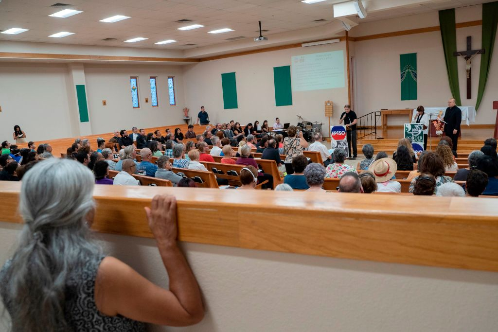 Attendees are pictured during the El Paso Interreligious Sponsoring Organization's assembly at St. Paul the Apostle Catholic Church to help the community discuss their feelings in the wake of the mass shooting in El Paso, Texas on August 8, 2019.