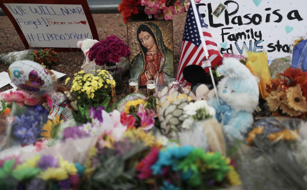 Flowers and mementos at a makeshift memorial outside Walmart, near the scene of a mass shooting which left at least 20 people dead in El Paso, Texas, on Aug. 4, 2019.