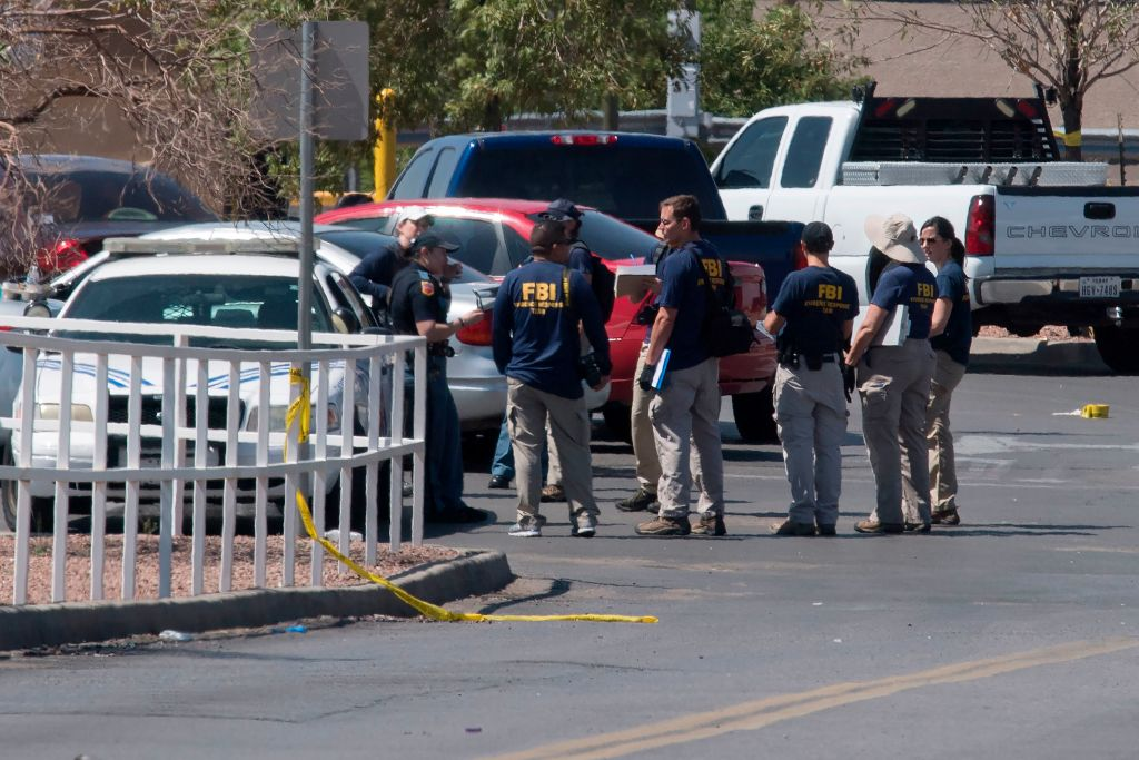 FBI agents check vehicles outside the Cielo Vista Mall Wal-Mart where a shooting left 20 people dead in El Paso, Texas, on August 4, 2019.