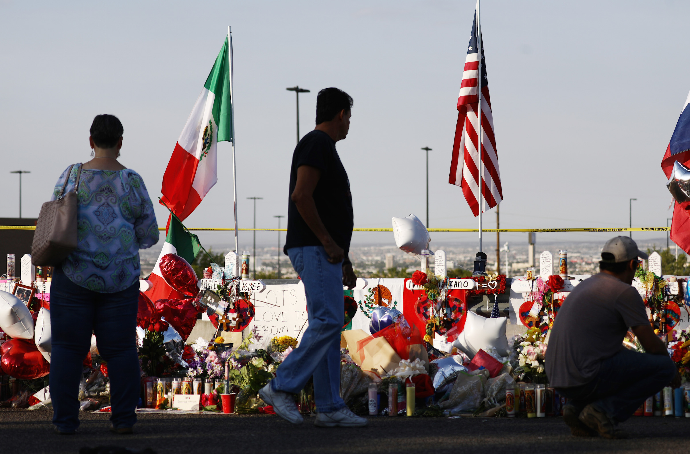 The Mexican and U.S. flags fly at a makeshift memorial honoring victims outside Walmart, near the scene of a mass shooting on Aug. 7, 2019 in El Paso, Texas.