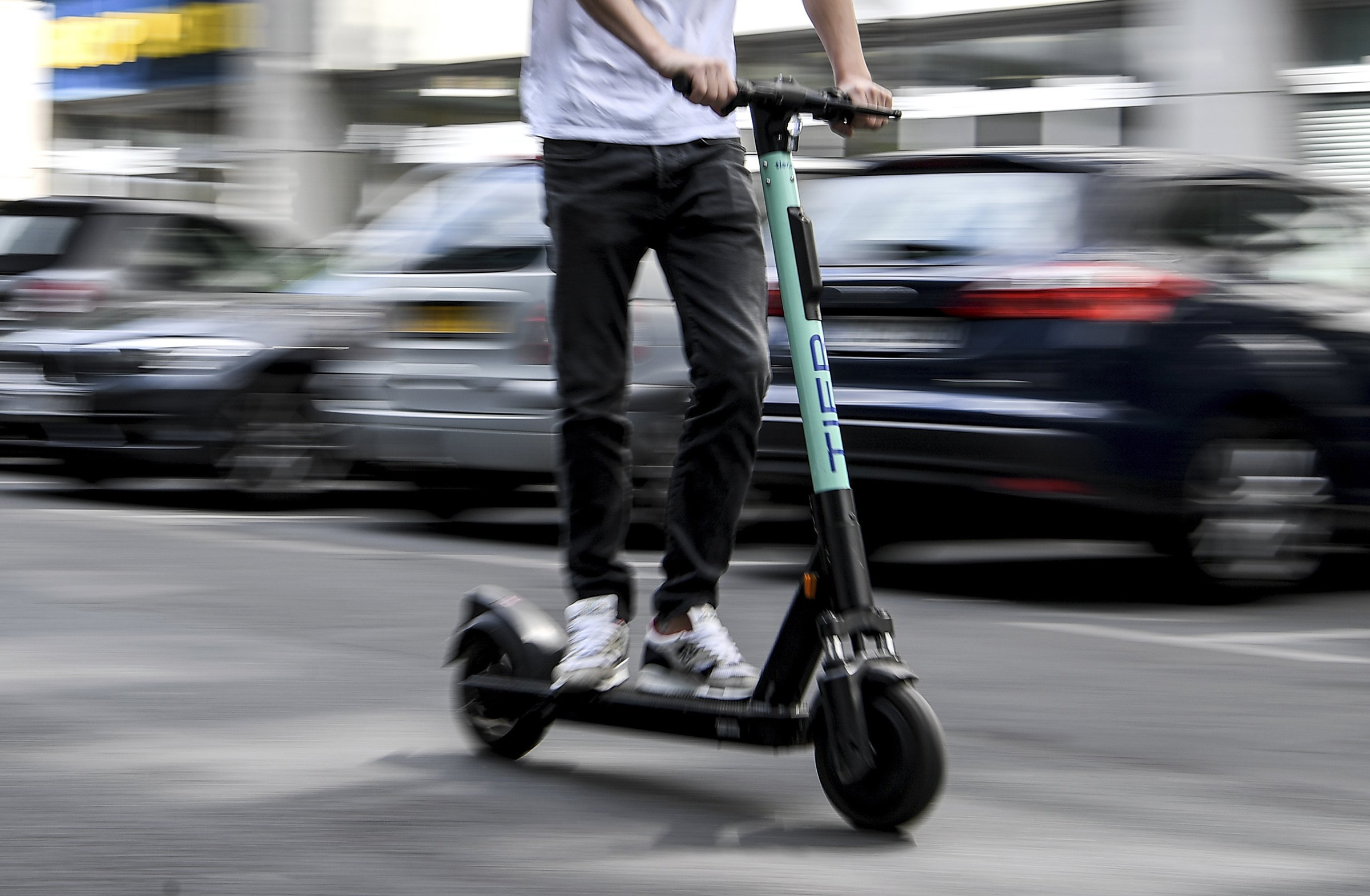 A man drives an electric pedal scooter from Tier in Berlin, Germany.