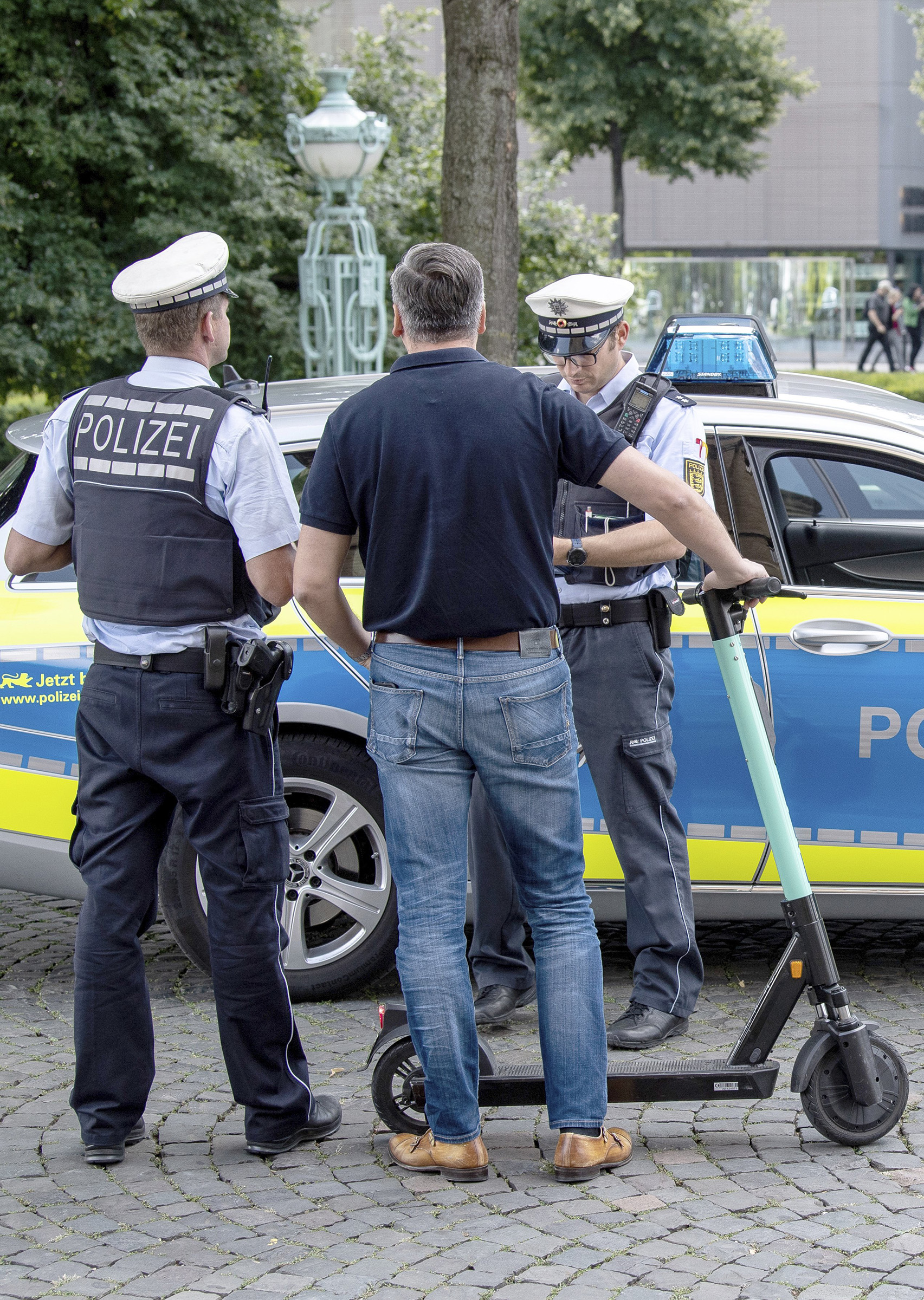 During a police check, an e-scooter driver is warned by the police because he has driven over a pedestrian path in Stuttgart, Germany.
