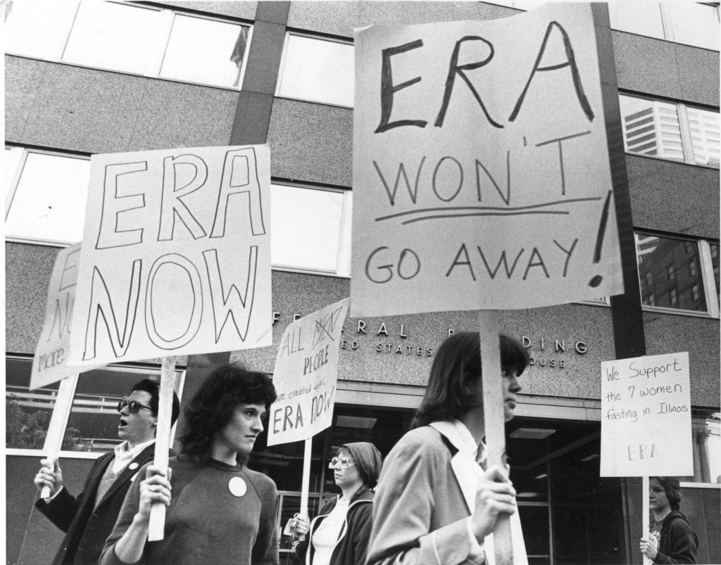 Demonstrators picketed outside the Federal Building in Minneapolis, June 9, 1982, in support of the Equal Rights Amendment and in silent vigil in support of seven fasting ERA supporters in Illinois.