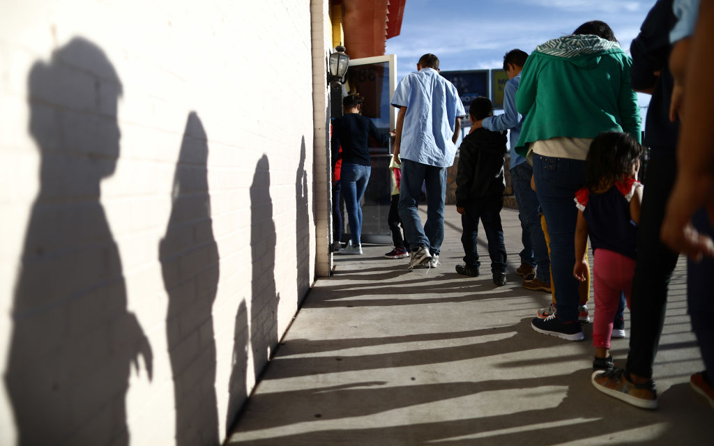 Recently arrived migrants from Central America line up to receive dinner at a church shelter for migrants who are seeking asylum on May 18, 2019 in El Paso, Texas.