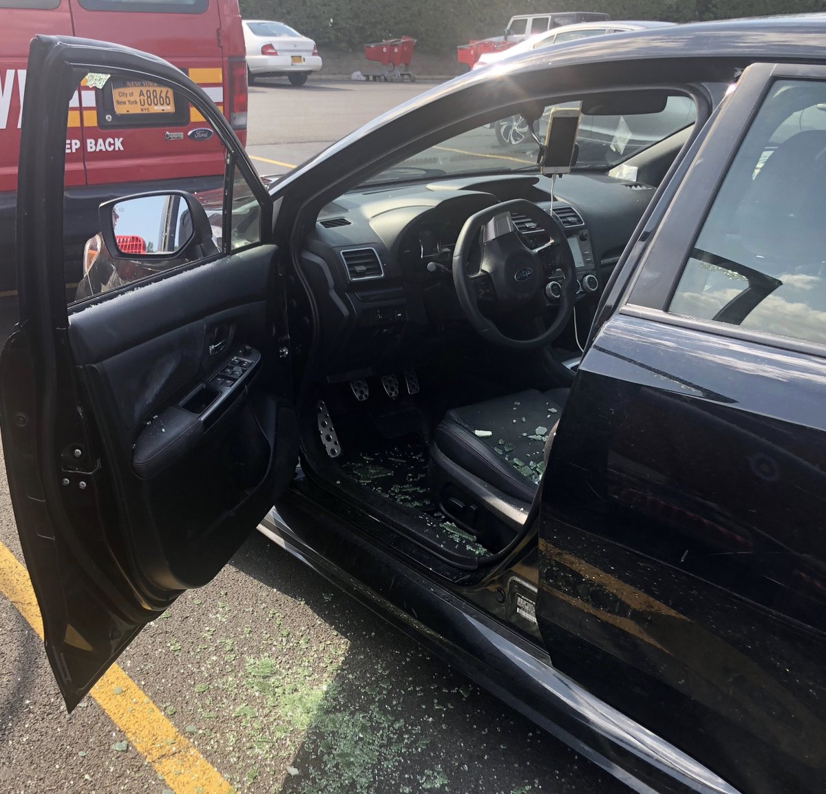 A car window in Queens, New York on Thursday, Aug. 8, 2019 broken in an effort to save a four-year-old boy from the overheating vehicle.