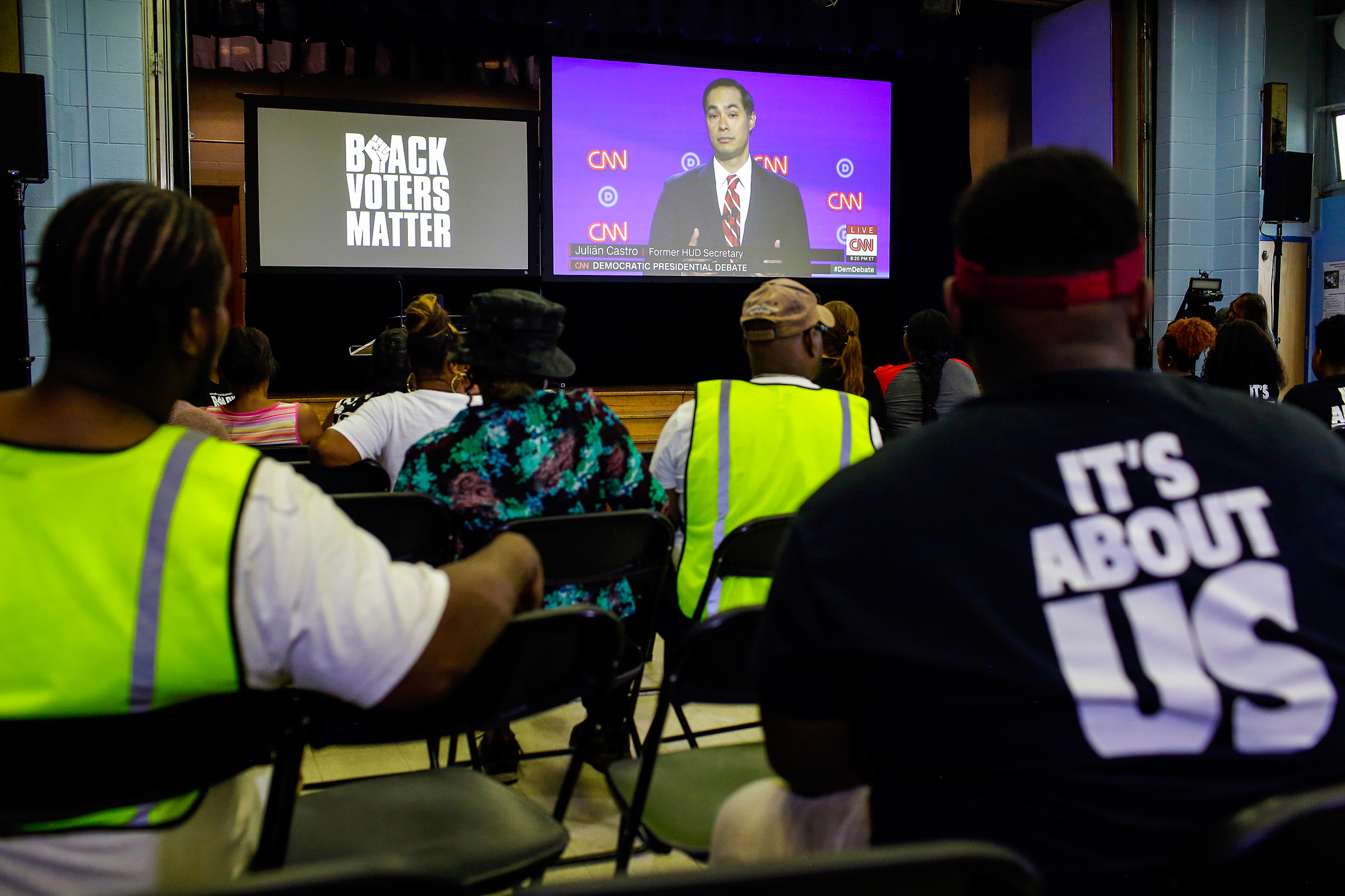 Attendees and residents of Flint watch the Presidential Debate during a watch party organized by Black Voters Matter at the Flint Development Center on July 31 in Flint, Michigan.