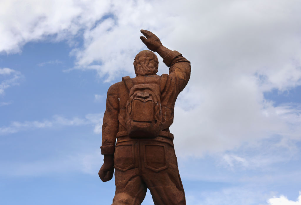A prominent statue labeled  Homage to the Migrant  stands in Salcaja, Guatemala's second city, reflecting respect for those who travel abroad to work and send money back home.