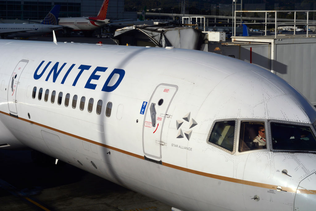 A United Airlines passenger aircraft prepares to leave its gate and taxi to the runway at San Francisco International Airport in San Francisco, California.