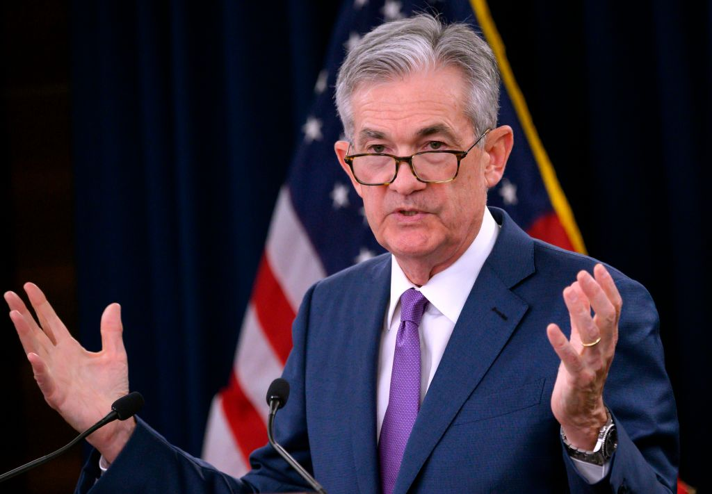 """US Federal Reserve Chairman Jerome Powell speaks during a press conference after a Federal Open Market Committee meeting in Washington, DC on July 31, 2019. Powell said the U.S. economy is in a favorable place but faces """"significant risks"""" on Friday as growth abroad slows amid trade uncertainty."""