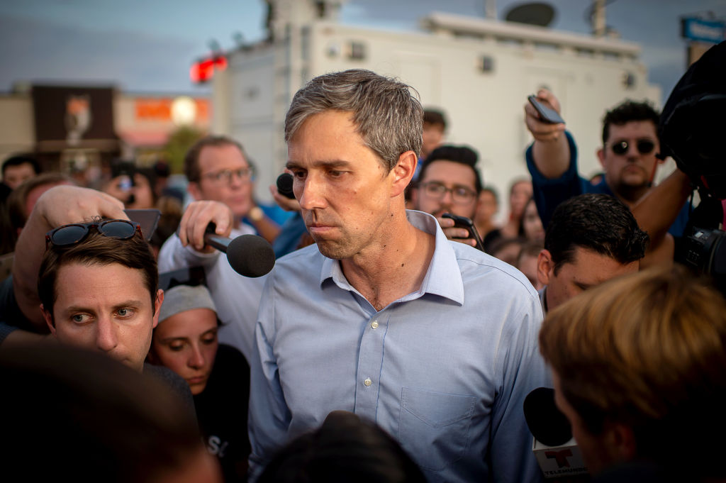 Beto O'Rourke, former Representative from Texas and 2020 Democratic presidential candidate, center, pauses as he speaks to members of the media outside Cielo Vista Walmart in El Paso, Texas, U.S., on Wednesday, Aug. 7, 2019. Donald Trump sought to console the grief-stricken residents of El Paso and Dayton on Wednesday, a trip that has so far been conducted largely out of public view following Democratic criticism of the presidents rhetoric on race and immigration and his positions on gun safety. Photographer: Luke E. Montavon/Bloomberg via Getty Images
