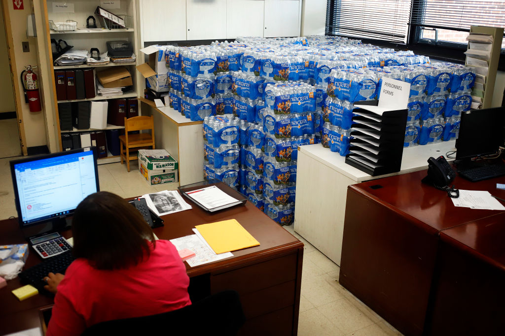 Water is stacked in several rooms scattered around the Newark Health Department which is acting as a distribution point for fresh water for residents affected by the city's ongoing water crisis due to lead contamination in some tap water. (Photo by Rick Loomis/Getty Images)