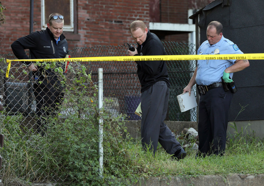 Police investigate the scene of a shooting in the 3500 block of North 14th Street in St. Louis, Mo., where a 7-year-old was shot and killed and an 18-year-old sustained a critical gunshot wound on Monday, Aug. 12, 2019. (David Carson/St. Louis Post-Dispatch/Tribune News Service via Getty Images)