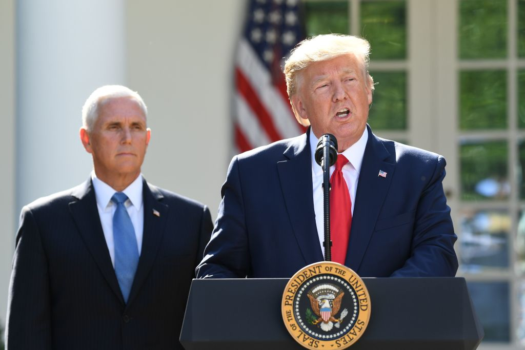 US President Donald Trump, flanked by US Vice President Mike Pence, speaks during an event establishing the US Space Command in the Rose Garden of the White House in Washington, DC, August 29, 2019. Trump announced Thursday that he canceled a trip to Poland this weekend because Hurricane Dorian is poised to strike Florida, and will send Vice President Mike Pence in his place.