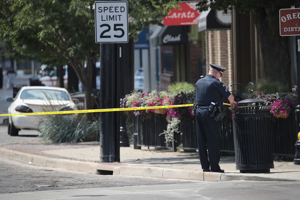 DAYTON, OHIO - AUGUST 04: Police continue their investigation after a mass shooting in a popular nightlife district on August 04, 2019 in Dayton, Ohio. At least 9 people were reported to have been killed and another 27 injured when a gunman identified as 24-year-old Connor Betts opened fire with a AR-15 style rifle.  The shooting comes less than 24 hours after a gunman in Texas opened fire at a shopping mall killing at least 20 people.