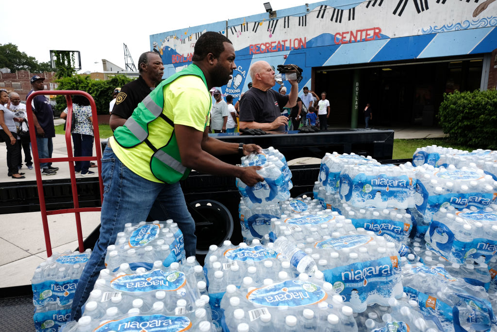 A pallet of bottled water is delivered to a recreation center on August 13, 2019 in Newark, New Jersey. Residents of Newark, the largest city in New Jersey, are to receive free water after lead was found in the tap water. (Photo by Spencer Platt/Getty Images)
