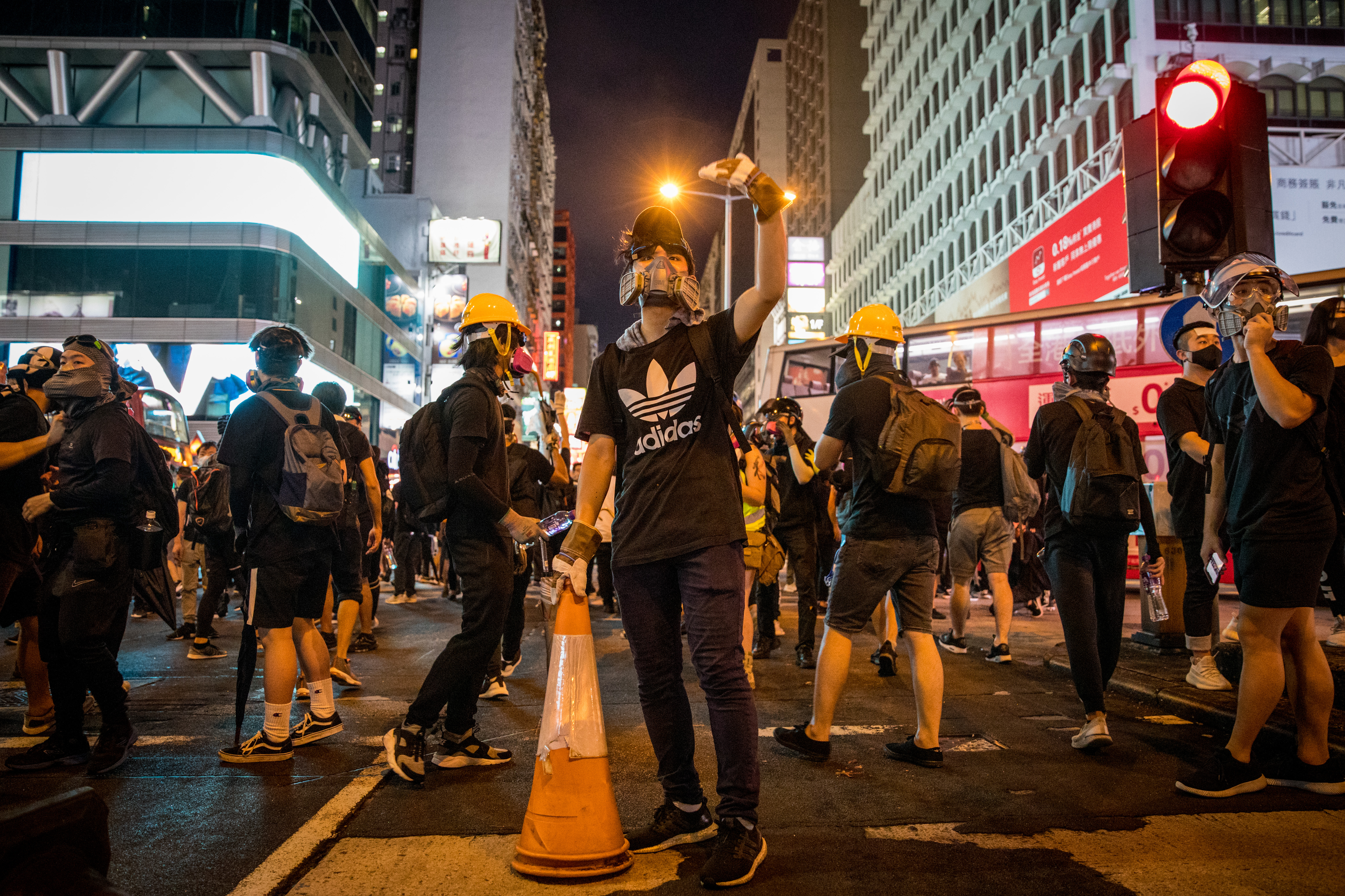 Pro-democracy protesters retreat as police advance on Nathan road on August 17, 2019 in Hong Kong, China.