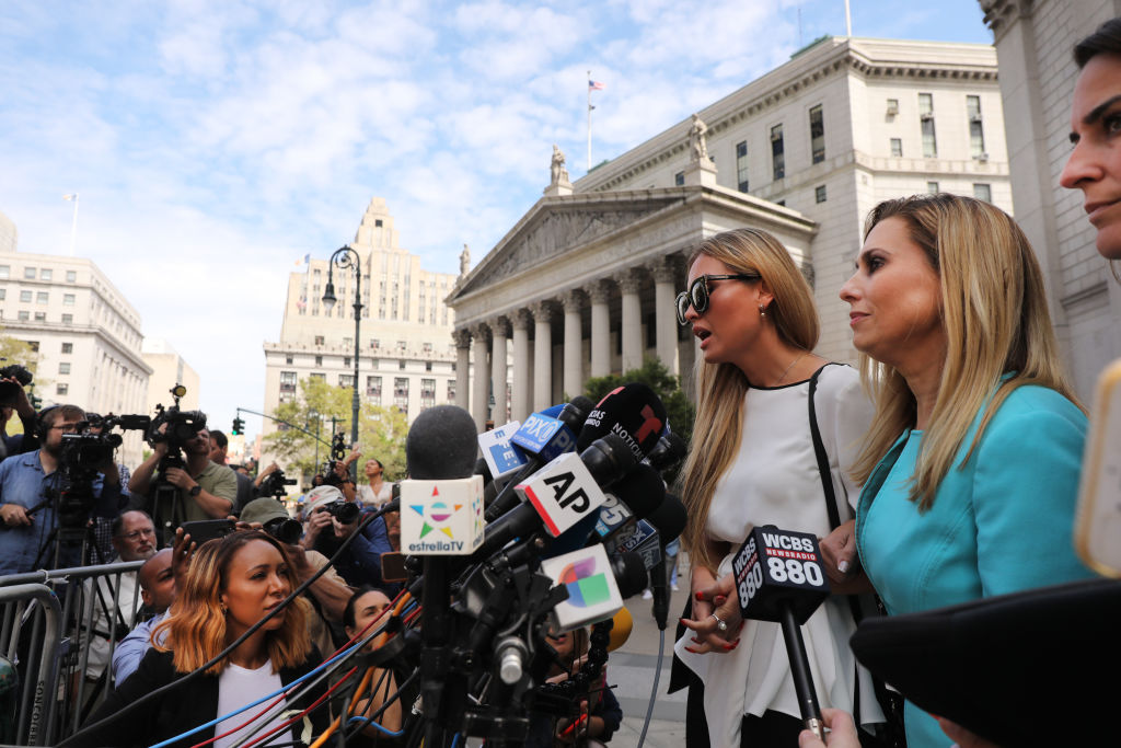 Jennifer Araoz, 32, who alleges that Jeffrey Epstein raped her in his New York townhouse in 2002 when she was only 14, speaks to the media with her lawyer after leaving the New York court house on August 27, 2019.