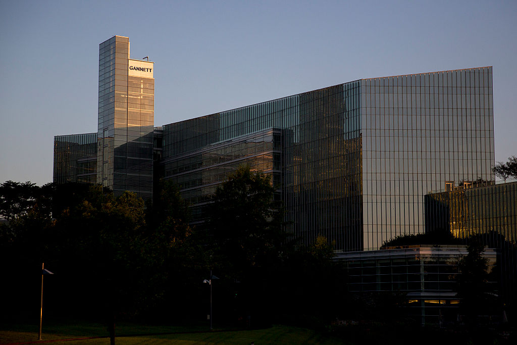The Gannett Co. Inc. headquarters stands in McLean, Virginia, U.S., on Friday, July 24, 2015. Following a June 29 spinoff of its broadcasting and digital businesses into a new company Tegna Inc., the new Gannett Co. Inc. has a portfolio of 110 media outlets in the U.S. and U.K., including USA Today and Newsquest, a regional U.K. publisher.