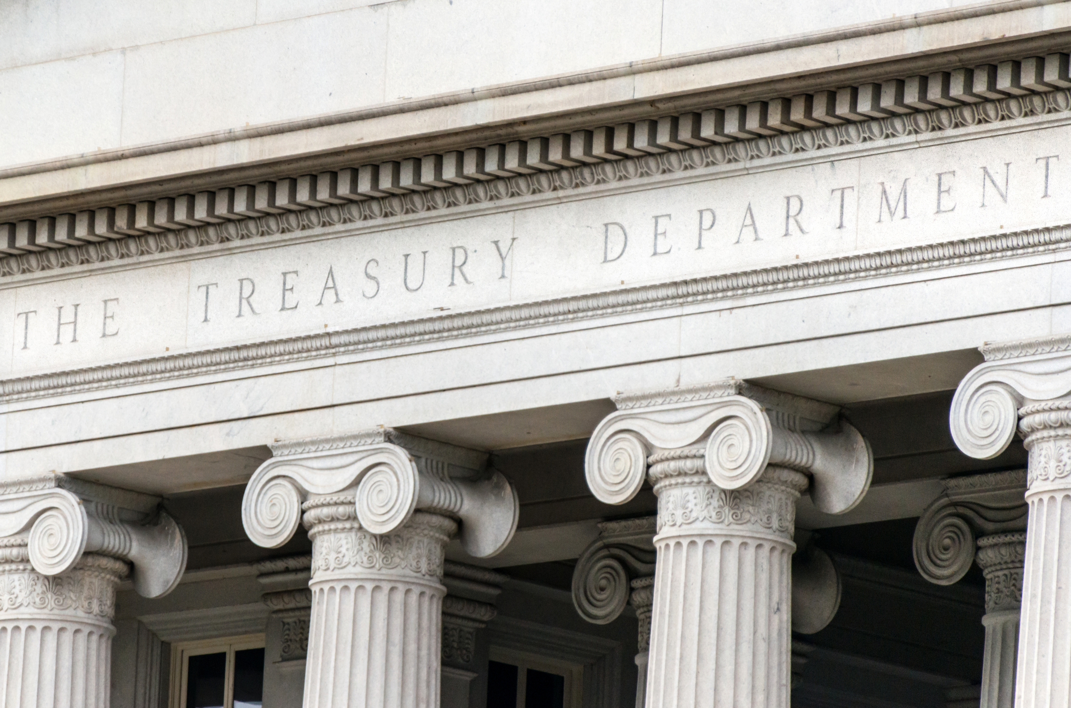U.S. Treasury Department sign in Washington D.C. building facade. The U.S. budget deficit is set to widen to $1 trillion by fiscal year 2020, two years sooner than previously estimated, according to the Congressional Budget Office findings Wednesday.