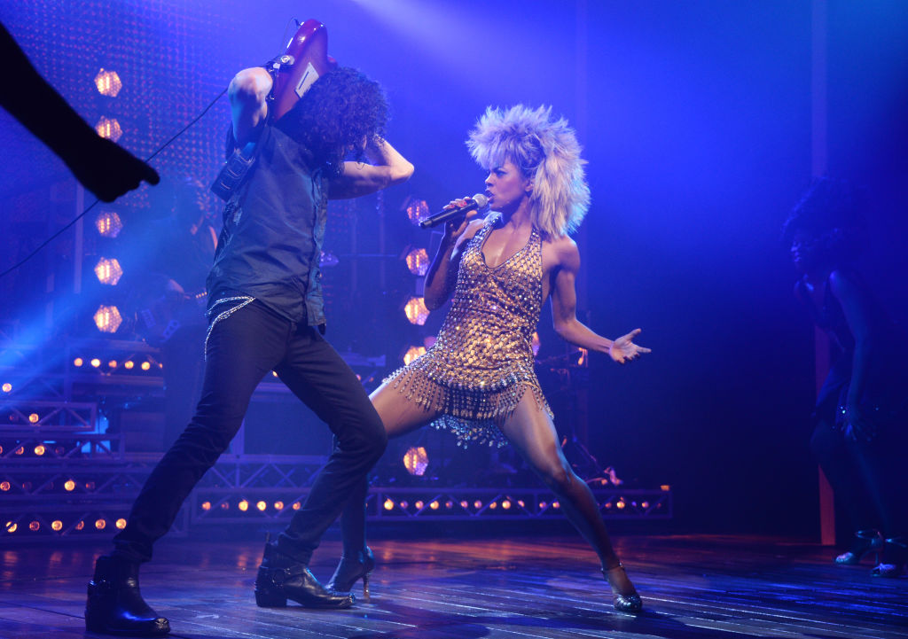 Adrienne Warren (R) as Tina Turner in a performance in London at the Aldwych Theatre on April 17, 2018