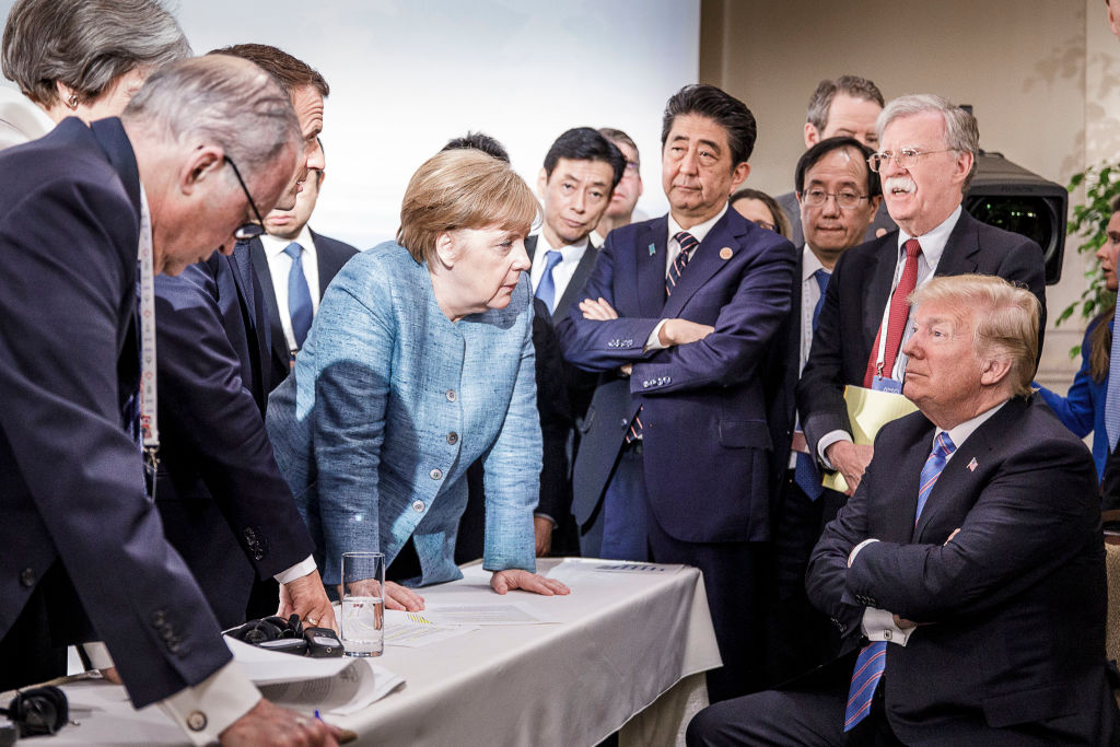 CHARLEVOIX, CANADA - JUNE 9:   In this photo provided by the German Government Press Office (BPA), German Chancellor Angela Merkel deliberates with US president Donald Trump on the sidelines of the official agenda on the second day of the G7 summit on June 9, 2018 in Charlevoix, Canada.