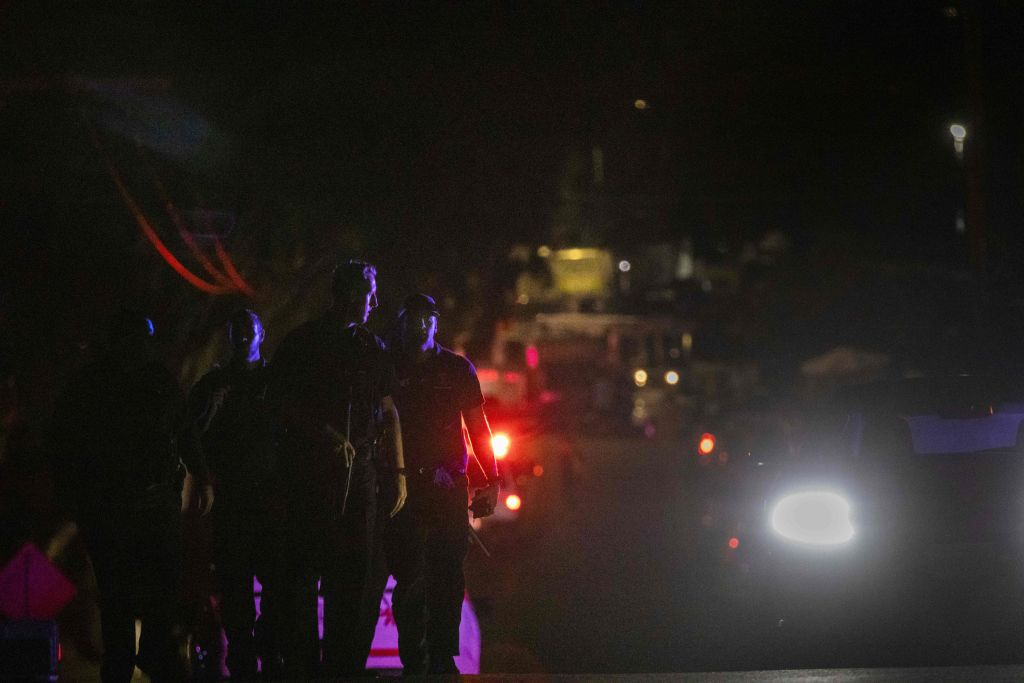 Police officers leave the scene of the investigation following a deadly shooting at the Gilroy Garlic Festival in Gilroy, California on July 28, 2019.