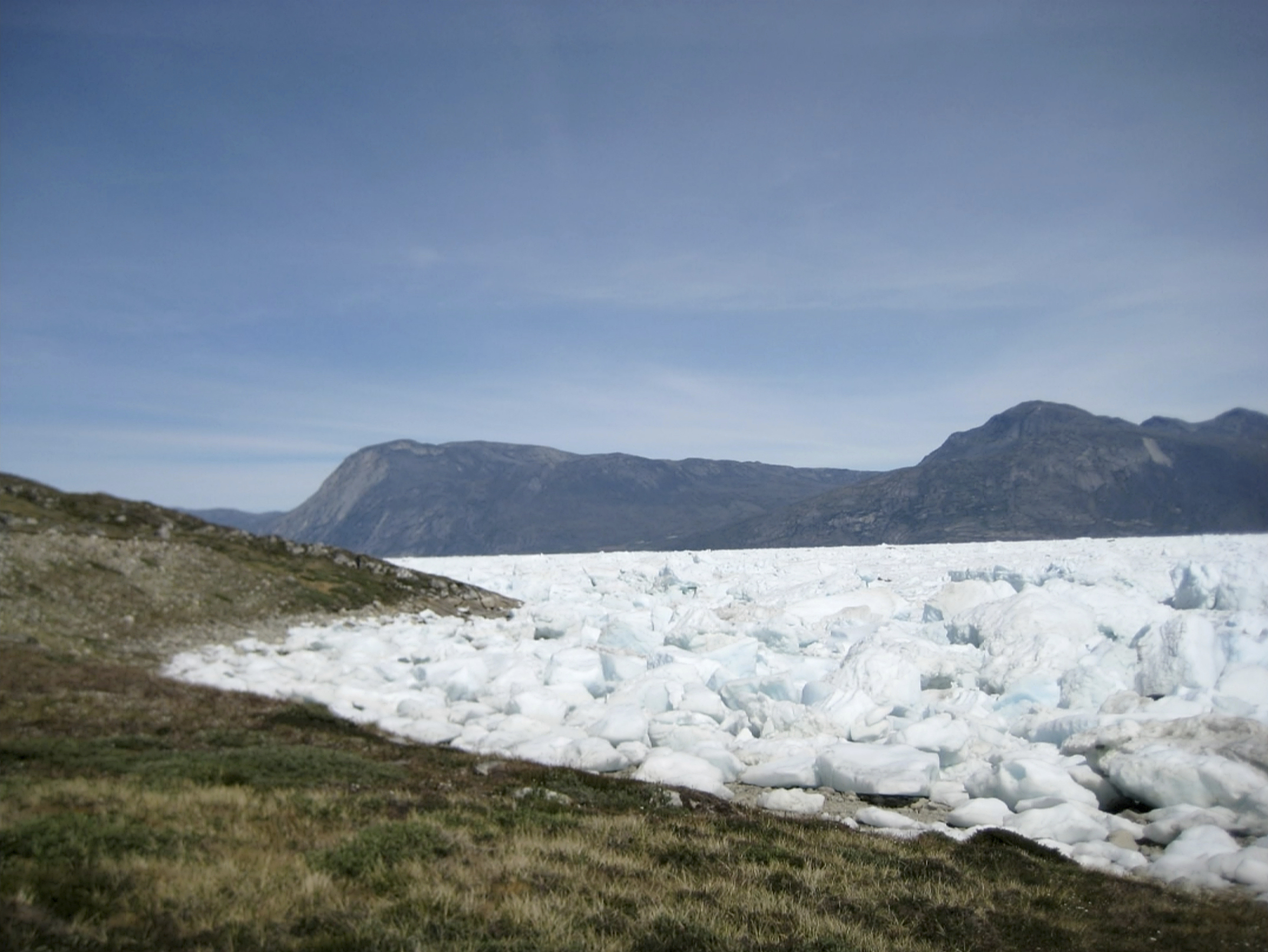 An image taken on June 18, 2019 of the Kangersuneq glacial ice fields in Kapissisillit, Greenland. Milder weather than normal since the start of summer, led to the UN's weather agency voicing concern that the hot air which produced the recent extreme heat wave in Europe could be headed toward Greenland where it could contribute to increased melting of ice.