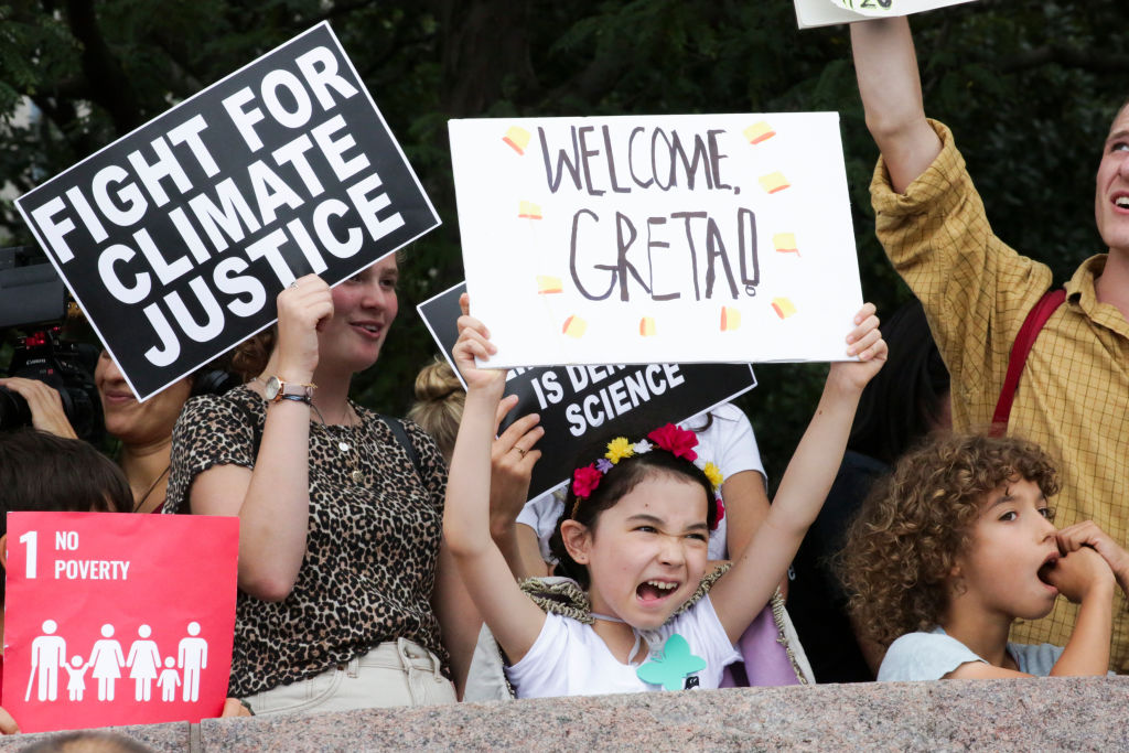 People welcome climate activist Greta Thunberg to New York as she arrives in the US after a 15-day journey crossing the Atlantic in the Malizia II, a zero-carbon yacht, on Aug. 28, 2019.