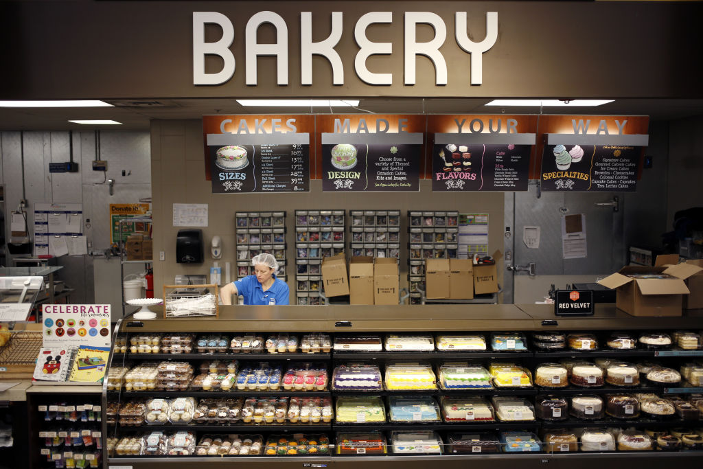 An employee works behind the bakery counter at a Kroger Co. supermarket in Louisville, Kentucky, U.S., on Tuesday, March 5, 2019.