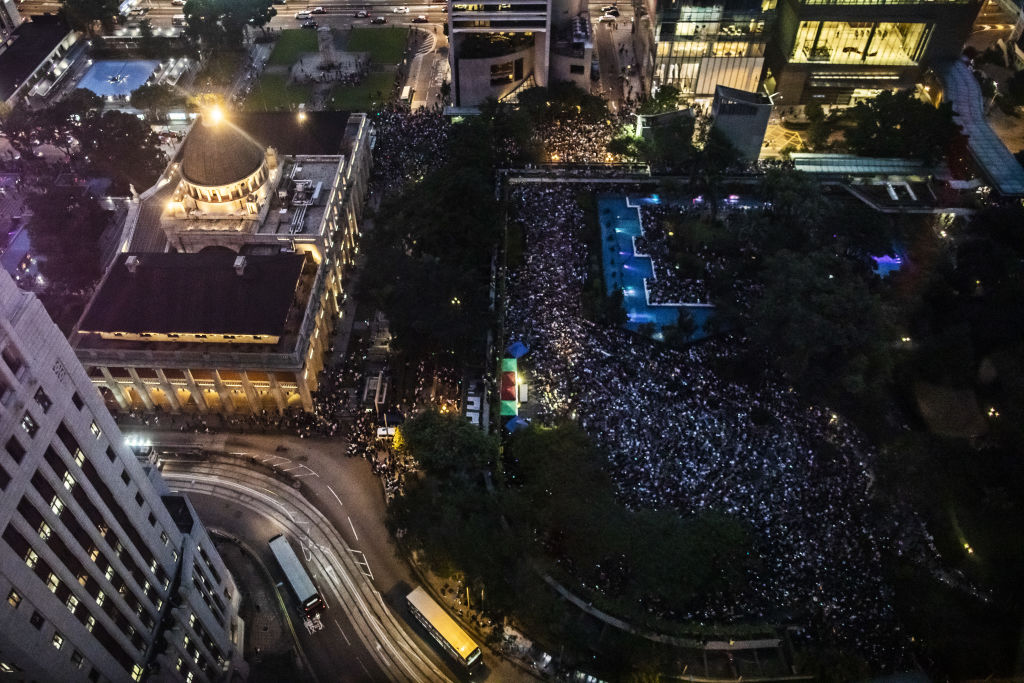Demonstrators gather during a rally organized by civil servants at Chater Garden in the Central district of Hong Kong on Aug. 2, 2019.