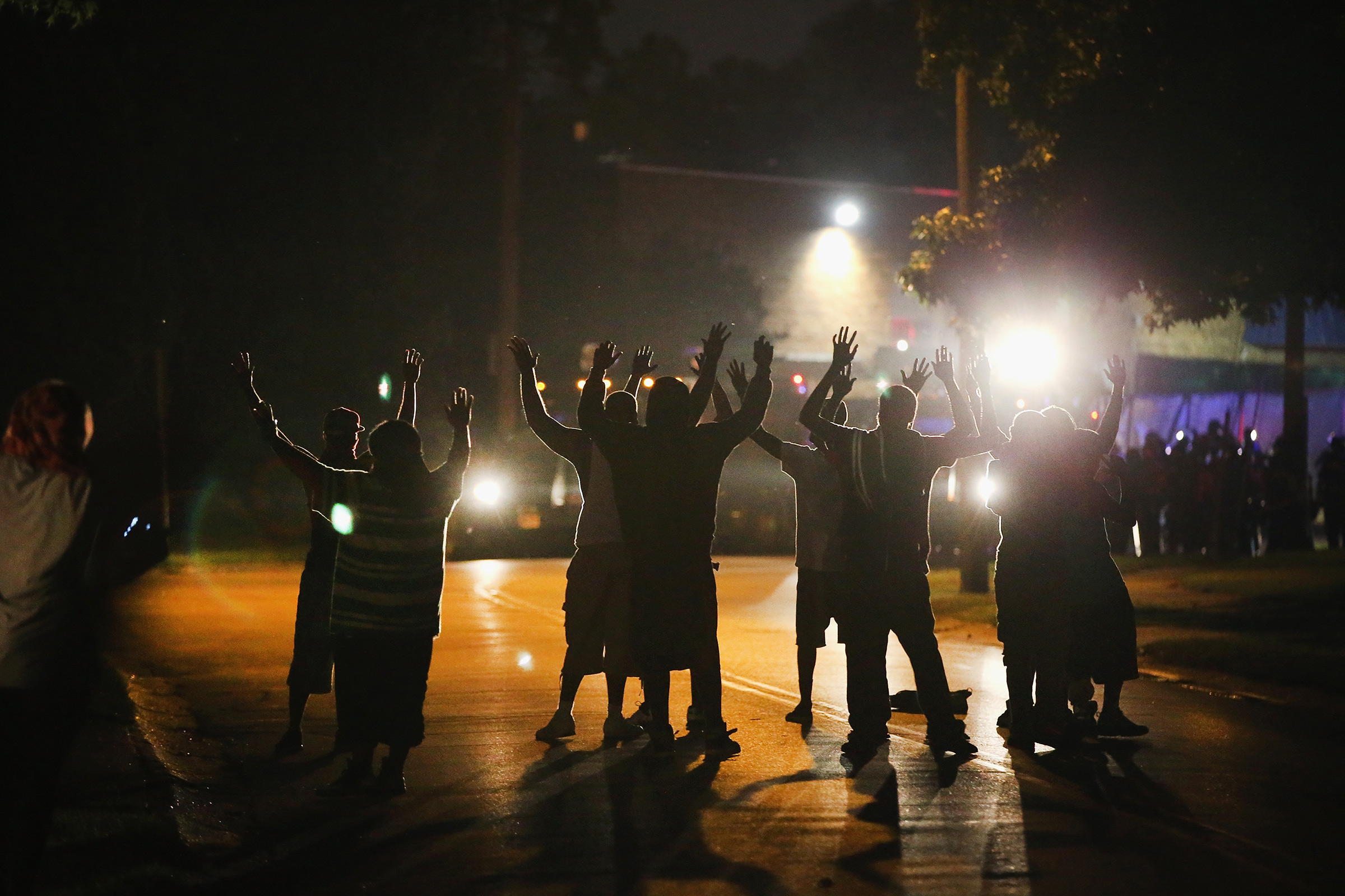 Police lock down a neighborhood in Ferguson amid protests in August 2014.