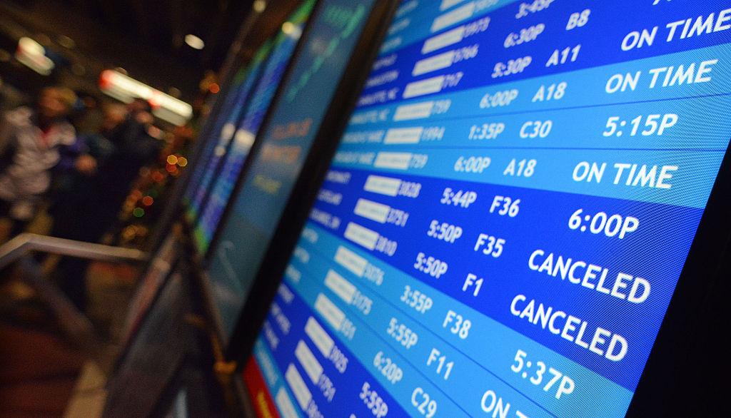 Flight departure displays indicate delayed or canceled fights at Philadelphia International Airport November 26, 2014 in Philadelphia, Pennsylvania.
