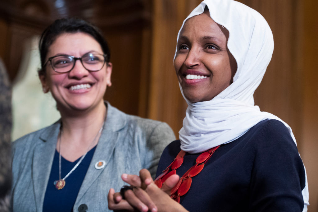Reps. Ilhan Omar and Rashida Tlaib attend a rally in the Capitol to introduce the  Equality Act,  on March 13, 2019.