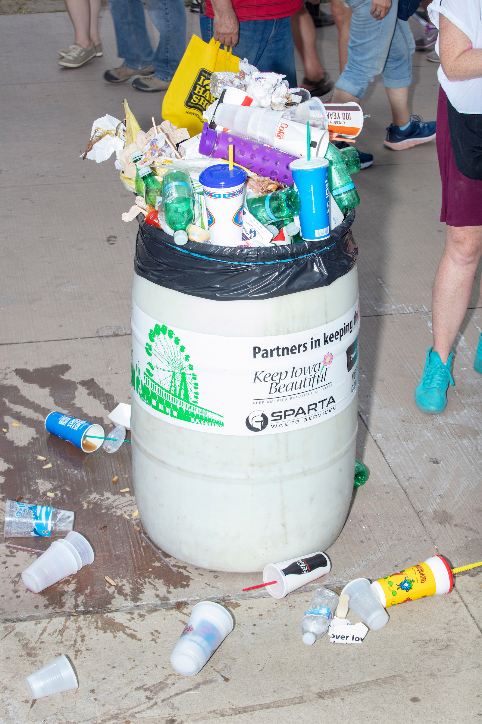 An overflowing trash can is seen at the Iowa State Fair on Sat., Aug. 10, 2019.