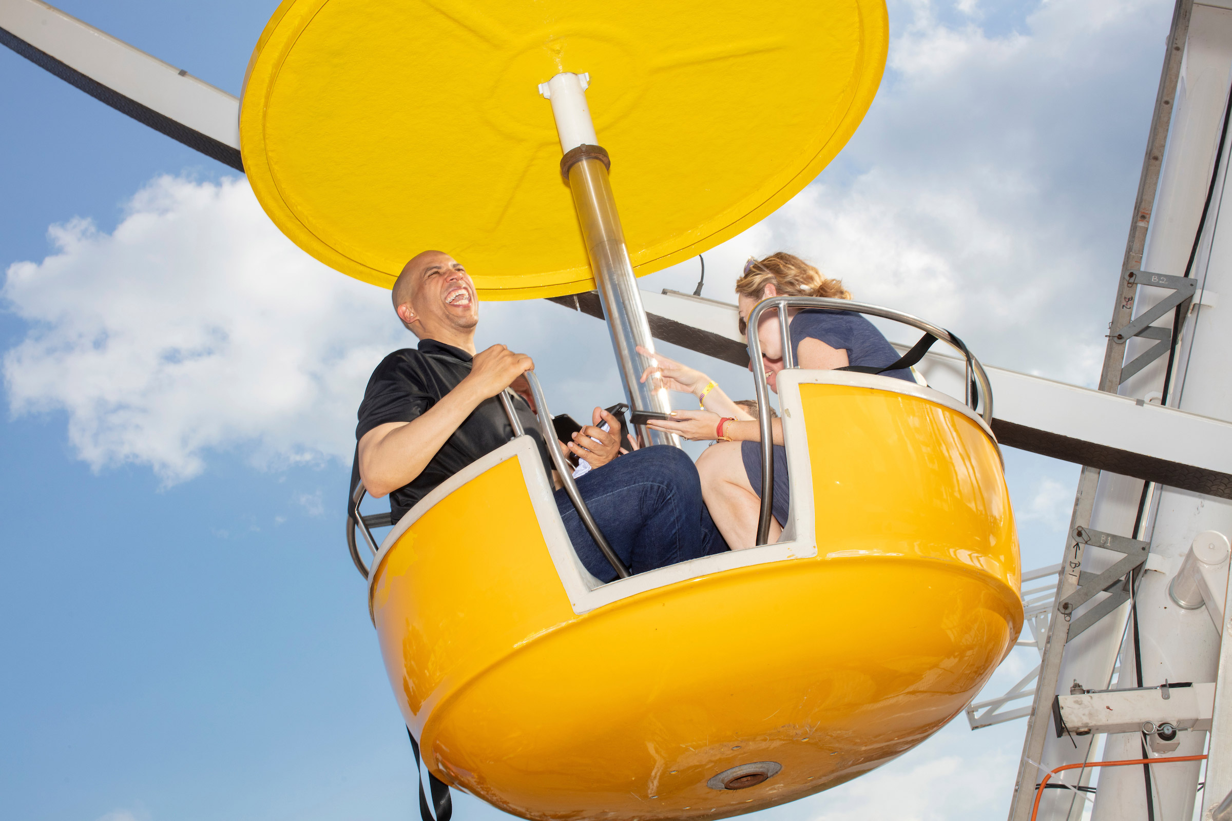 Democratic presidential candidate Cory Booker rides the ferris wheel on Aug. 10.